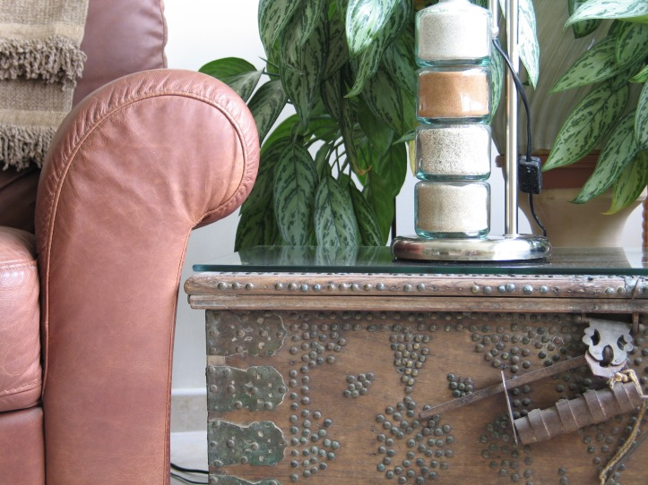 Leather chair, Iranian Chest, and Sands of the desert