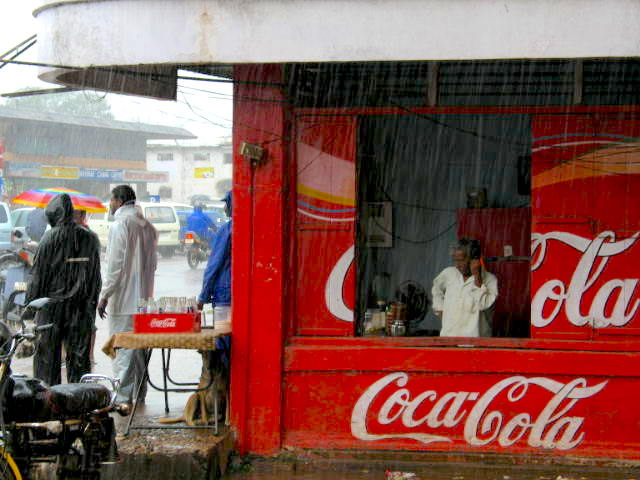 Rain suits, umbrellas, Coke, and phones--what's not to love