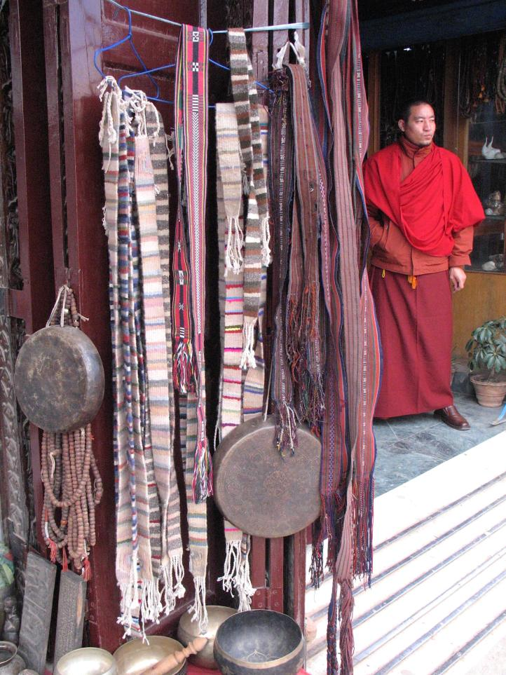 Monk in Katmandu selling Buddhist stuff