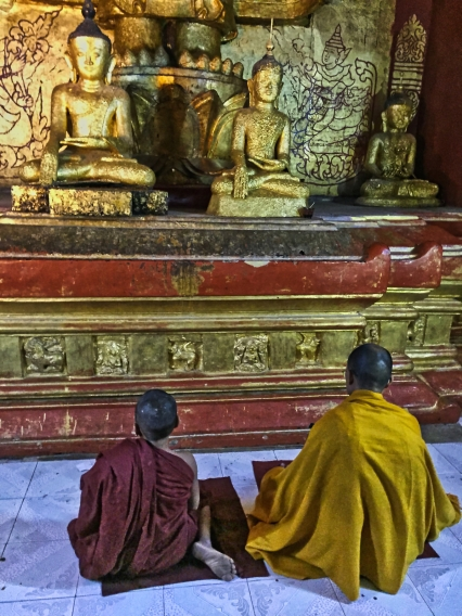 2 monks at Buddhist altar