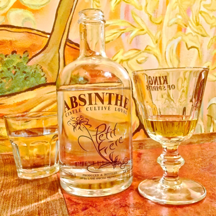 absinthe glass with water bottle