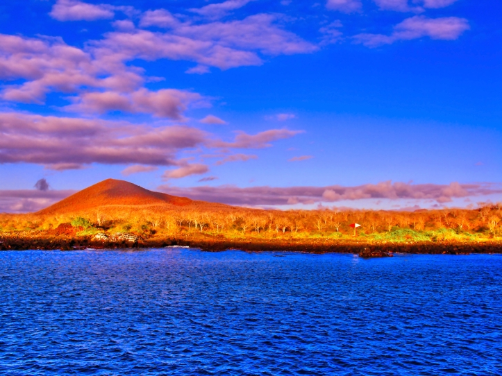 island with blue sea & colorful clouds