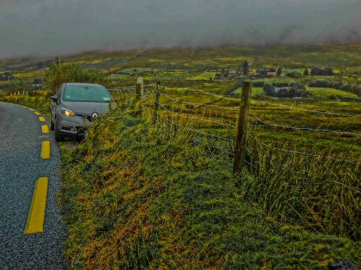 Irish road w/rain, grasslands